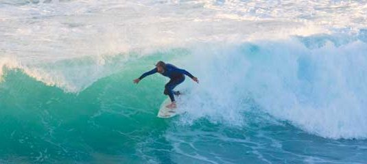Surfer riding large waves in Fuerteventura