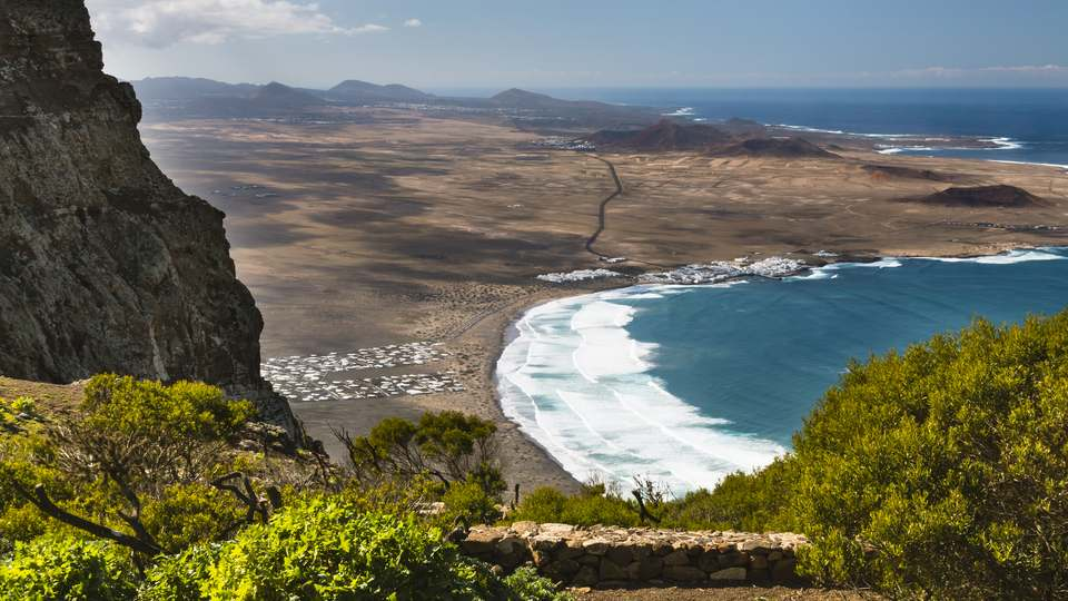 View of Caleta de Famara and Urbanización Famara From Above