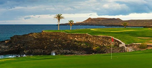 Golf course along rocky coastline